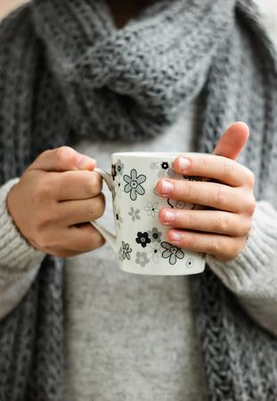 drink tea: Cup of hot drink in childrens hands