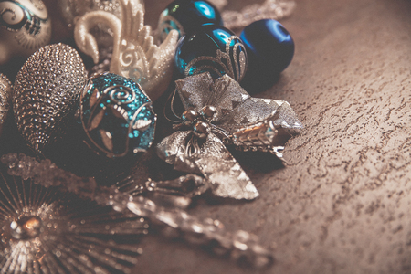 Beautiful silver and blue christmas balls for 2019 New Year on a dark background. Copy space