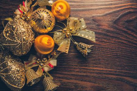 New Year 2019 Compostion of golden decor on dark wooden background Standard-Bild
