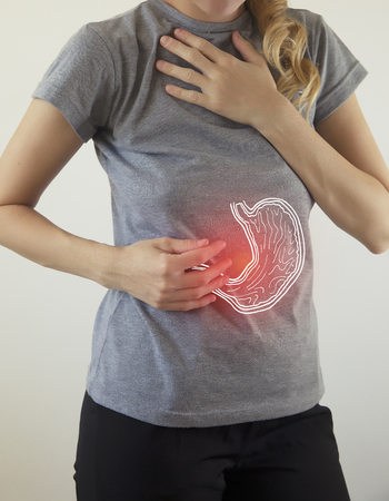 Digital composite of highlighted red pain  stomach of woman Stock Photo - 120839491