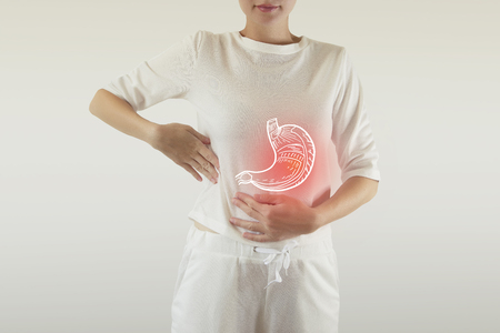Digital composite of highlighted red pain  stomach of woman Stock Photo - 120839612