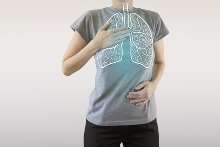 highlighted blue  healthy lungs on woman body Archivio Fotografico