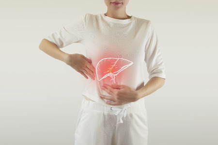 Digital composite of highlighted red painful liver of woman  healthcare & medicine Stock Photo