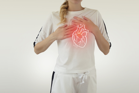 highlighted red heart disease on woman body Stock Photo