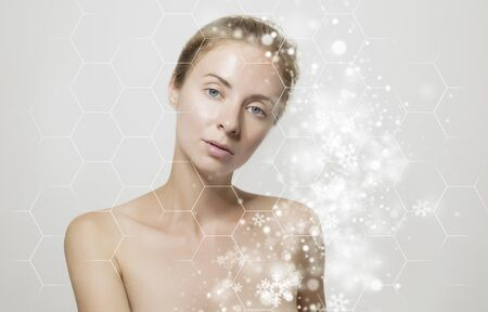 Young beautiful woman with clean perfect skin and snowflakes close-up. Beauty, youth, skin care