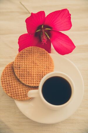 fresh homemade round waffles with hot drink in cup