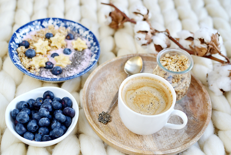 Fresh Breakfast Yogurt with Muesli Banana Berries Chia Seeds Granola Cotton Flower White  Knit Blanket Bedroom Healthy Lifestyle