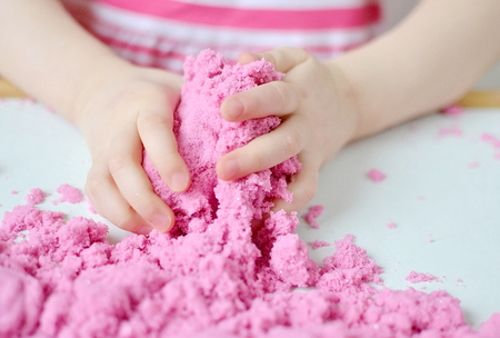 Little Caucasian Girl Playing with Pink Kinetic Sand at Home, Early Education, Preparing for School, Development, Plastic Molds