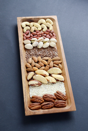 Assorted mixed nuts, peanuts, almonds, walnuts, pistachios, pecan, cashew, hazelnuts. Healthy food concept Banque d'images