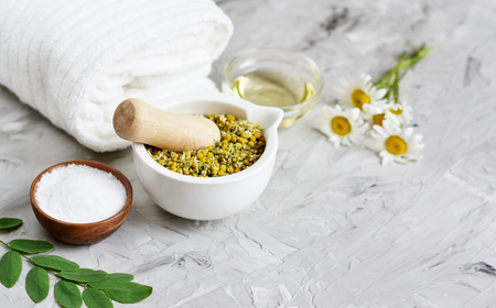 Dried chamomile flowers, natural ingredients for homemade body, face salt scrub, mask, SPA concept