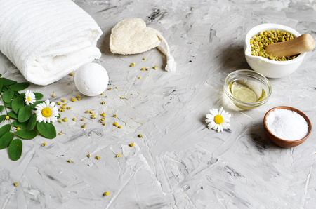 Dried chamomile flowers, natural ingredients for homemade body, face salt scrub, mask, SPA concept Banco de Imagens