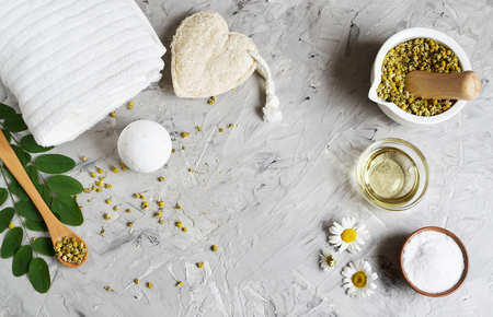 Dried chamomile flowers, natural ingredients for homemade body, face salt scrub, mask, SPA concept Imagens