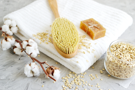 Natural Ingredients for Homemade Body Oatmeal Scrub Soap White Towel Beauty Concept Skincare Organic Wooden Body Massage Brush Aroma Spa Therapy Cotton Flower