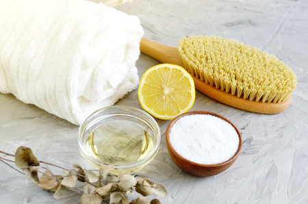 Natural Ingredients for Homemade Body Salt Scrub Lemon Olive Oil White Towel Beauty Concept Skincare Organic Wooden Body Massage Brush Aroma Spa Therapy Stock Photo