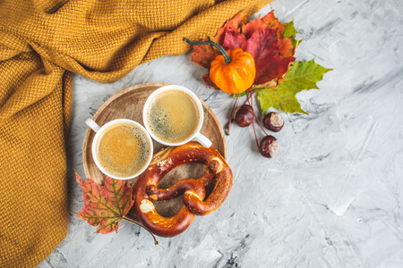 Tea Cup with Coffee Autumn Time Bakery Pretzel Toned Photo Knitting Scarf Blanket Yellow Leaves Gray Background Stock Photo