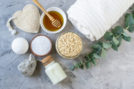 Natural Ingredients Homemade Body Oatmeal Sea Salt Scrub with Olive Oil Honey Milk White Towel Beauty Concept Skincare Organic Aroma Spa Therapy