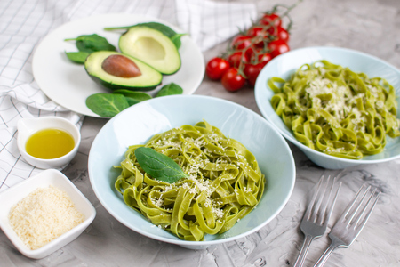 Cooked green spinach tagliatelle pasta on a plate