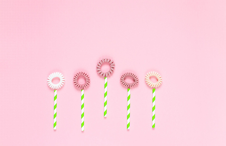 Flowers from pink background, spring concept, flat lay, womans day