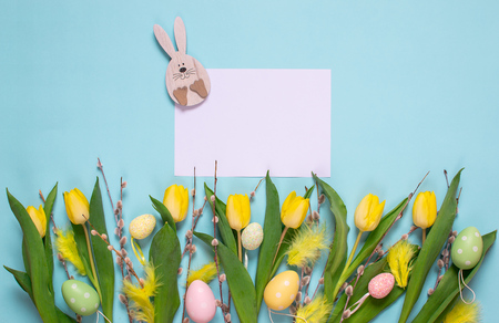 Yellow tulip bouquet, blue background, spring time. Easter day concept. Top view. Copy space. Womans day. Mothers day