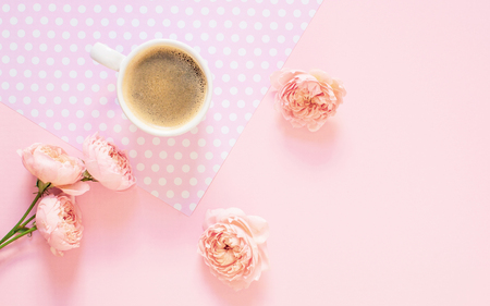 Composition of white cup with pink background. Morning concept. Flat Lay. Top view
