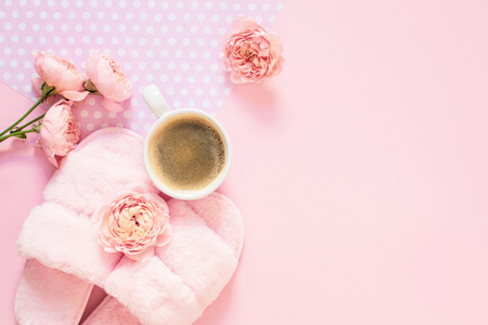 Composition of flowers on a light pink background. Morning concept. Flat Lay. Top view