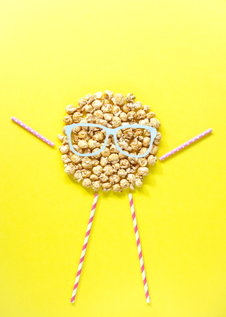 People head from popcorn, Top view. Copy space.