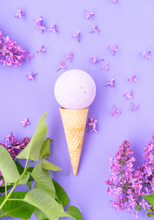 Composition of ice cream on a violet background Bathroom cosmetic accessories. Flat Lay. Top View. Lilac flowers Фото со стока - 123510636