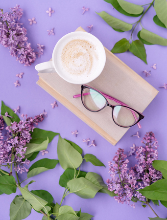 Cappuccino, book with glasses