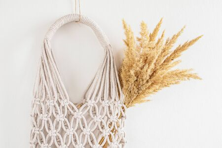 Handmade macrame shopping bag on the background, ECO friendly. Embroidery. Modern summer concept