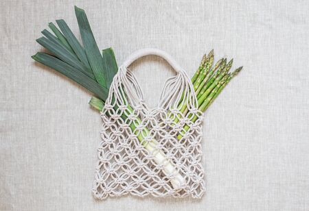 Handmade macrame shopping bag on the light background