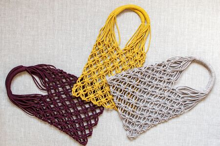Handmade macrame shopping bags on the light background, ECO friendly