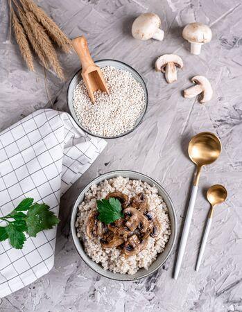 Pearl barley porridge with mushrooms, healthy food concept, breakfast