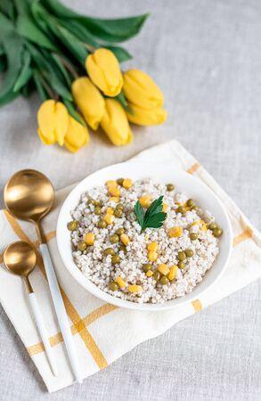 Pearl barley porridge with vegetables, healthy food concept, breakfast