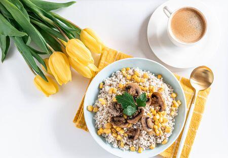 Pearl barley porridge with mushrooms and corn, healthy food concept, breakfast, black coffee