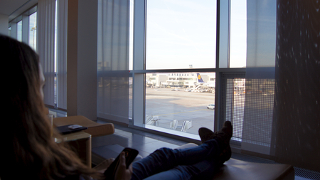 comfy: Passenger sitting in a comfy chair at the First Class Lounge in Frankfurt