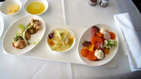 This is Lufthansa First Class dining onboard an Boeing 747-400 upper deck.