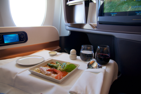 A perfect steak as an inflight meal in Business Class on my way to Singapore Stock Photo