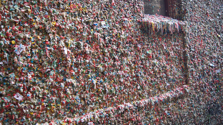 local landmark: The Market Theater Gum Wall in downtown Seattle on October 10, 2014. It is a local landmark in downtown Seattle, in Post Alley under Pike Place Market. Stock Photo