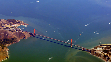 an aerial view of golden gate bridge and downtown sf, taken from a plane.