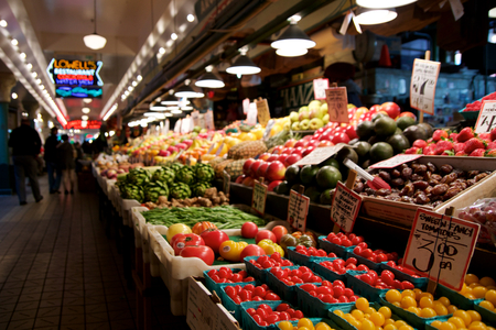 SEATTLE, WASHINGTON, USA - JAN 24th, 2017: Vegetables for sale in the high stalls at the Pike Place Market. This farmer market is a famous sight in downtown