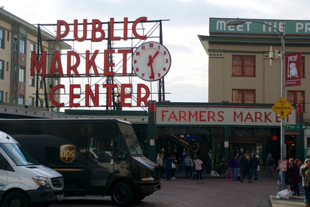 pike place: SEATTLE, WASHINGTON, USA - JAN 24th, 2017: Entrance to the Pike Place Market in Seattle Downtown. The market opened in 1907 and is still a major tourist attraction on the waterfront