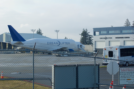 exclusively: EVERETT, WASHINGTON, USA - JAN 26th, 2017: Boeing 747 Dreamlifter parking at Snohomish County Airport or Paine Field. The Dreamlifter is used exclusively to transport 787 Dreamliner parts to the Boeing factory