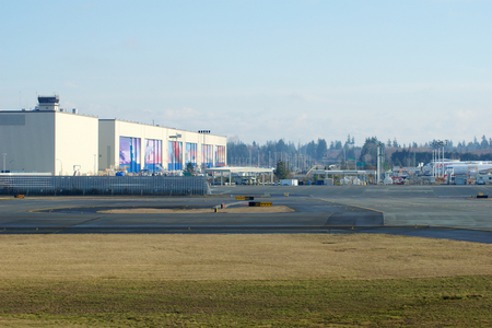 EVERETT, WASHINGTON, USA - JAN 26th, 2017: Boeings New Livery Displayed on Hangar Doors of Everett Boeing Assembly Plant at Snohomish County Airport or Paine Field Editorial