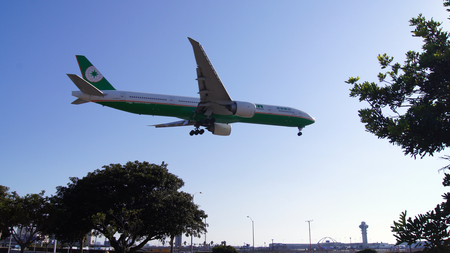 LOS ANGELES, CALIFORNIA, USA - OCT 9th, 2014: EVA Air Boeing 777 shown shortly before landing at the LA Airport LAX. Editorial