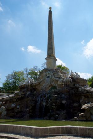 schloss schonbrunn: VIENNA, AUSTRIA - APR 30th, 2017: View of Obelisk Fountain Obeliskbrunnen in the public park of Schonbrunn Palace Editorial