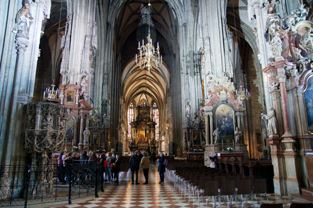 saint stephen cathedral: VIENNA, AUSTRIA - APR 29th, 2017: Built In 1147 Saint Stephens Cathedral Stephansdom is the mother church of the Roman Catholic Archdiocese of Vienna and the seat of the Archbishop of Vienna. View from inside with many visitors during the day