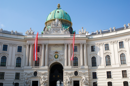 VIENNA, AUSTRIA - APR 29th, 2017: Famous entrance of the Hofburg Palace in Vienna. It was the Habsburgs principal winter residence, currently serves as the residence of the President of Austria