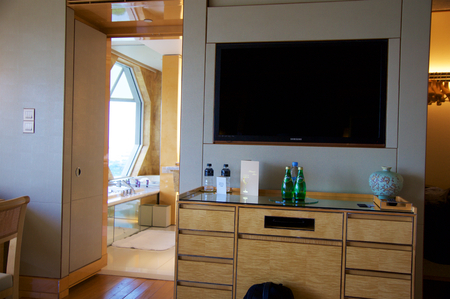 suite: SINGAPORE - JULY 23rd, 2016: luxury Hotel room with modern interior, a comfortable bed and an awesome view of the Marina Bay, LCD TV Editorial