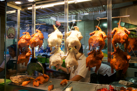 sg: SINGAPORE - JULY 23rd, 2016: duck grilled or roasted hanging in cupboard-glass at Lau Pa Sat Festival Market