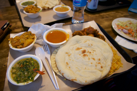 SINGAPORE - JULY 23rd, 2016: Indian dish curry lunch set at Lau Pa Sat Festival Market